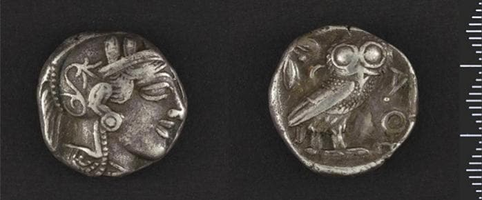 A coin from ancient Athens depicting the goddess Athena and her owl, part of Cornell's numismatics collection.