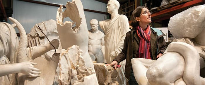 Prof. Annetta Alexandridis examines relics of the Cornell's cast collection, currently under restoration.