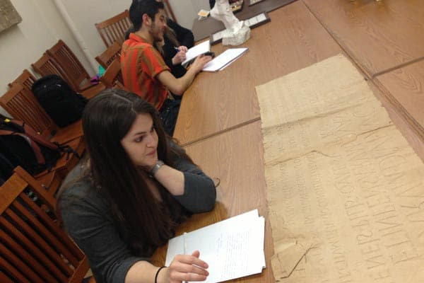"""Students examining squeezes, casts and other Cornell teaching collections during a workshop on """"The Materiality of Replication"""", held by the Cornell-Yale Consortium for the Study of Ancient Art."""