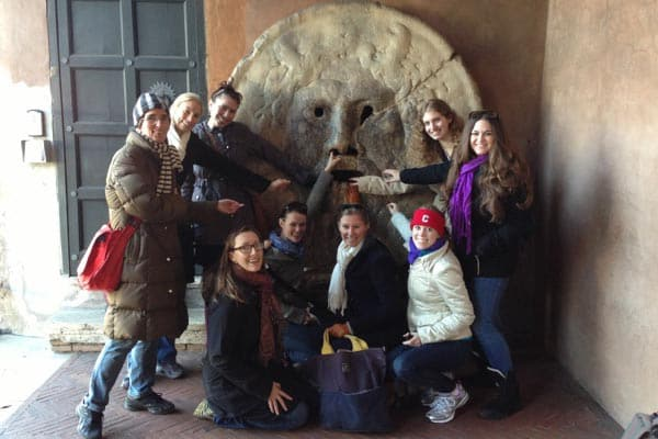 "Students with Prof. Annetta Alexandridis in front of the Bocca della Verità, Rome, as part of a traveling seminar on ""Roman Sculpture in Context."""