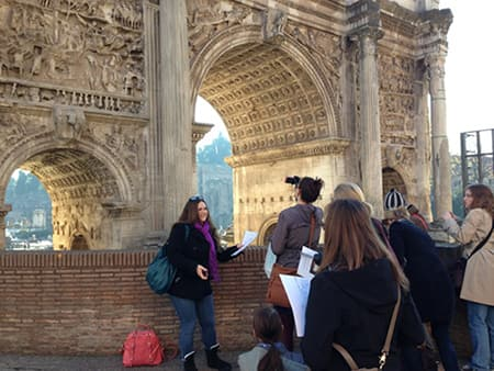 "Student presents on the Arch of Septimius Severus in the Roman Forum, as part of a traveling seminar on ""Roman Sculpture in Context."""