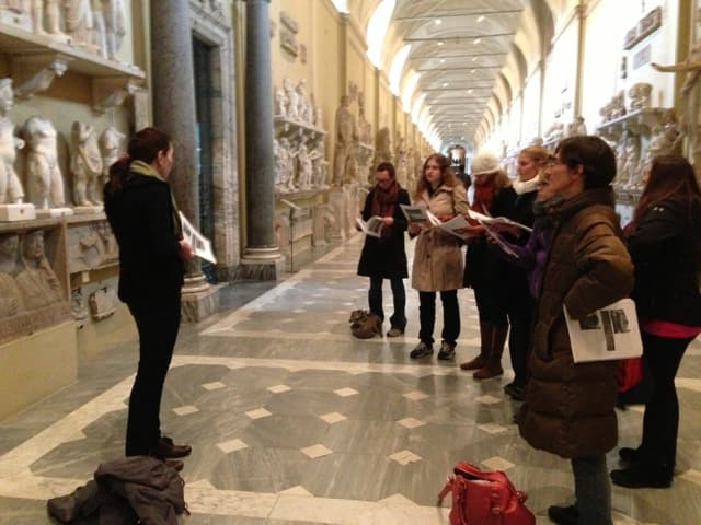 "Student delivers a presentation in the Vatican Museums, Rome, as part of a traveling seminar on ""Roman Sculpture in Context."""