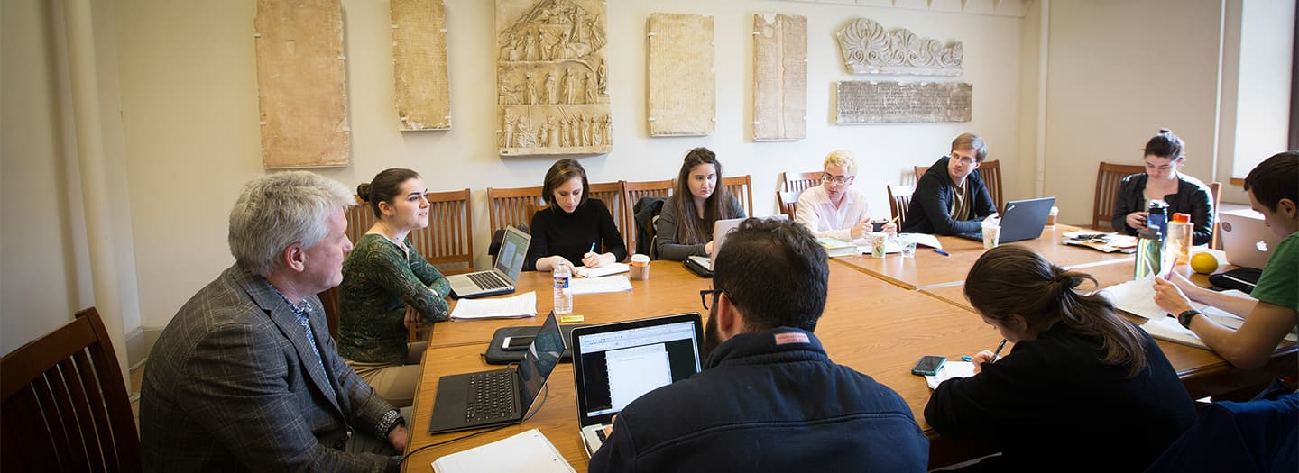 "Students examining squeezes, casts and other Cornell teaching collections during a workshop on ""The Materiality of Replication"", held by the Cornell-Yale Consortium for the Study of Ancient Art."