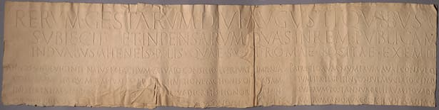 """A monumental squeeze of the Res Gestae Divi Augusti. The """"squeeze"""" is made by laying dampened paper over an incised surface which is then beat with a flat brush and let to dry."""